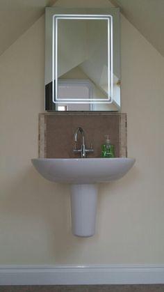 Wall mounted sink.