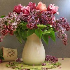 Preview wallpaper lilacs, tulips, flower, spring, vase, petals, napkin 1024x1024
