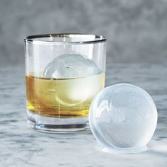 sphere ice molds - I don't get it, but my husband is obsessed with these for his drinks!