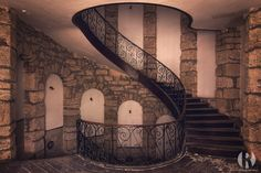https://flic.kr/p/NWUqF7 | Ssstaircase. | This is a photo of a staircase in a beautiful abandoned castle that has been built in the 17th century. It's actually been built on a medieval fortification. The castle has had several purposes. Children used to celebrate holidays here, it's been a spa and even a center for drug addicts. About 20 years ago it became abandoned.  Visiting this place was a lovely adventure. It was raining, we had to walk through fields of grass and climb up slippery…