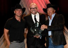 George Strait Photos Photos - Kenny Chesney, Tony Martell Lifetime Entertainment Achievement Award recipient Louis Messina, and George Strait during the T.J. Martell Foundation 9th Annual Nashville Honors Gala at Omni Hotel on February 27, 2017 in Nashville, Tennessee. - 2017 Nashville Honors Gala - Show