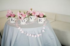 Anthro mugs turned wedding decor #pink | Photography: CLY Creation - clycreation.com  Read More: http://www.stylemepretty.com/2014/05/06/modern-blush-pink-wedding/