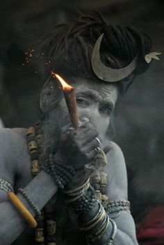 Aghori, smoking out of a chillum / found via Nischal Karki