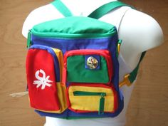 United Colors of Benetton school bags ....I didn't have a backpack, but a tote in the same colors with the same metallic button.....
