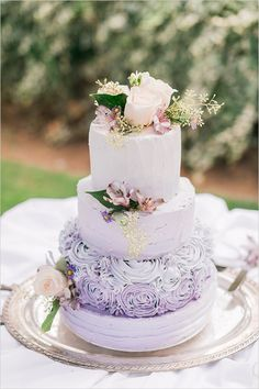 ombre purple wedding cake with different textured tiers