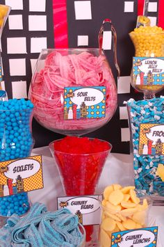 What's a Superhero-themed party without a Super Hero Candy Buffet? Guests can enjoy candy in the form of superhero-style. Girl Superhero Party, Superman Party, Superhero Baby Shower, Wonder Woman Birthday, Wonder Woman Party, Avengers Birthday, Boy Birthday, Sour Belts, Candy Buffet