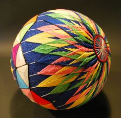 "These stunning embroidered balls called ""temari"" were made by the prodigiously nimble fingers of a 92-year-old grandmother in Japan. Although she only lear"