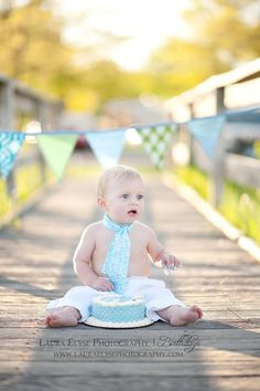 cake smash on a walkway at the beach newborn-little-guy-photography