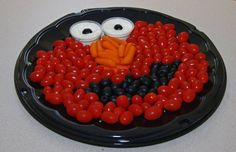 Sesame Street Veggie Tray    The items needed for this vegetable tray are:  Head = Grape Tomatoes  Nose = Mini Carrots  Mouth = Black Olives  Eyes = Ranch Dressing     This same look can be achieved using a fruit tray. Here's how:  Head = Strawberries  Nose = Mandarin Oranges  Mouth = Black Grapes  Eyes = Banana Slices