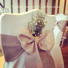 Wax flower decorations look very pretty on the back of the sashes. Other flower decorations available.