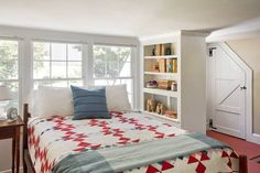 The guest room in this 1850 redo features an angled door and bookshelf privacy divider. | Photo: Eric Roth | thisoldhouse.com