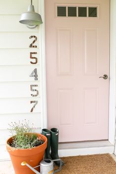 Pale pink front door. The Dempster Logbook.