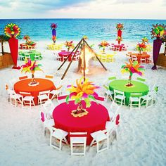 Now that's a colorful reception!  #beachwedding #beach #reception