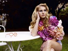Fascinating... Lana Del Rey dressed in a flower blossom top.