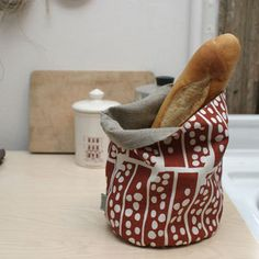 Fabric baskets/buckets are great for all sorts of uses in the home. I've made a few that are a similar shape to this one. Food safe, reusable, beautiful... all that and washable, too!