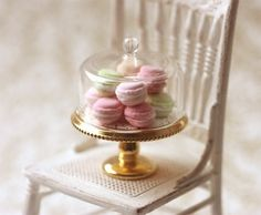Mini macarons in a glass display. These cookies are perfect for the displays since they have to rest at least 24 hours anyway