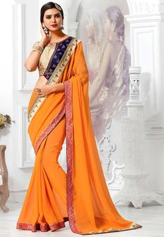 Faux Georgette Saree in Orange This Eyecatcher Drape is Enhanced with Resham and Patch Border Work Available with a Semi-stitched Art Silk Embroidered Blouse in Beige and Navy Blue. Crafted in Boat Neck and Half Sleeve. Blouse Length- 13 to 15 inches, Sleeve Length- 8 to 9 inches Free Services: Fall and Edging (Pico) Do note: Accessories shown in the image are for presentation purposes only.(Slight variation in actual color vs. image is possible).