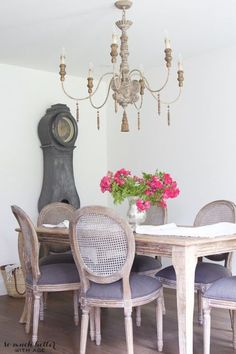 While this dining set and lighting fixture may have looked more formal with a darker wood stain, their shabby chic finish keeps the room casual.  See more at So Much Better With Age.
