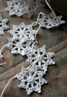 Crochet Garland - Wall Hanging - Small Doily Bunting -- Snowflake garland - Snow White. $23.00, via Etsy.
