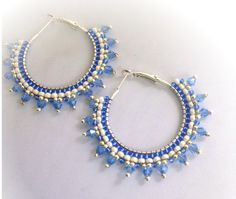 Glass seed beads of silver and intense blue colors are stitched on a 1.25 inch silver plated. Sky blue bicone crystals add sparkle as they catch the light. Big enough to make a statement, but still delicate in appearance.
