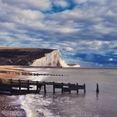 The beautiful Seven Sisters.. #cuckmere #wood #seadefence #groin #aged #sea #river #reflection #countryside #countrywalk #coast #nationaltrust #nature #sevensisters #clouds #tranquil #landscape #seascape #landmark #grass #riverbank #sussex #cloudscape #contrast #naturereserve #natural #heathfield #wildlife #birds #weald