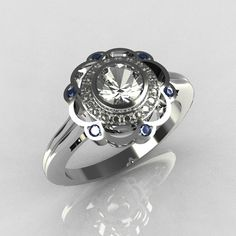 Cartier Style 950 Platinum 0.50 Carat Round SI-2 G-I Diamond Blue Topaz Engagement Ring R70-PLATGDBT. $3,299.00, via Etsy.