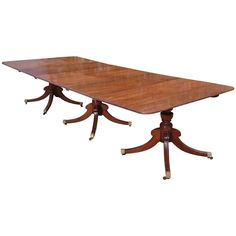 Magnificant Regency Three Pedestal Dining Table | From a unique collection of antique and modern dining room tables at https://www.1stdibs.com/furniture/tables/dining-room-tables/