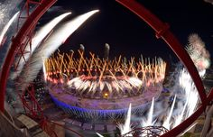 Fireworks illuminate the sky over the Olympic Stadium during the Opening Ceremony of the 2012 Summer Olympics, on July 27, 2012.