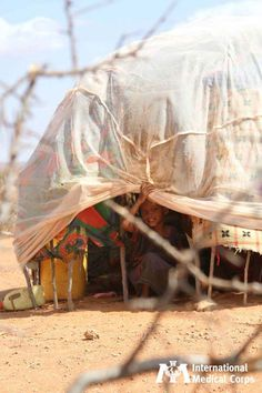 August 2: A child sits under a makeshift shelter in one of Ethiopia's Dolo Ado refugee camps.    Photo: Annerie Jansen Van Rensburg/International Medical Corps, Ethiopia 2011