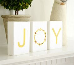 """Create some JOY wood blocks for your Christmas decor using Sandpaper, Modge Podge, a little paint, the Cricut Explore, and your printer!  Designed by Amy From """"The Idea Room""""."""