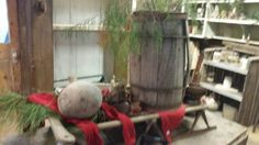 Table decor ...old barrel..ice skates..red stockings and fresh pine..Christmas at the cabin!  2015