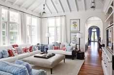 Light and airy.  White living room with neutral sofa and accents colors. #coastal #living room #design