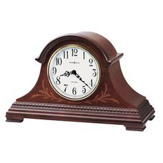 Howard miller quartz chiming mantel Clock cherry Finish 635115 MARQUIS.This tambour styled mantel clock features a decorative inlay pattern of multiple hardwoods.An arched molding crowns the case, while the base features a carved wood molding that wraps around the front and sides of the clock.Off-white dial features black Arabic numerals, A polished brass tone bezel, and convex glass crystal.Quartz, dual-chime Finished in Windsor Cherry on select hardwoods and veneers.