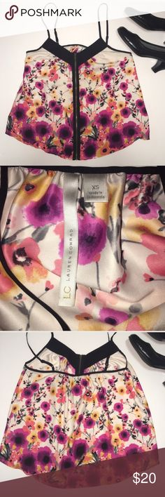 LC Lauren Conrad floral tank Beautiful floral tank by Lauren Conrad. Features a zipper on front and adjustable straps. EUC. 🌸automatically save when you bundle or make an offer through the offer button🌸 LC Lauren Conrad Tops Tank Tops