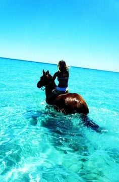Ocean view horseback riding. Amazing and beautiful photo of a girl riding a horse in the ocean.