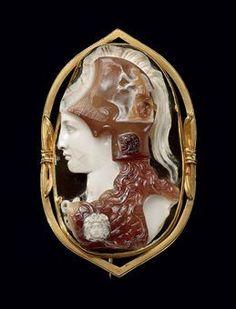Roman cameo bust of Minerva, circa 1st century C.E. Sardonyx, mounted on a 19th century gold brooch setting.