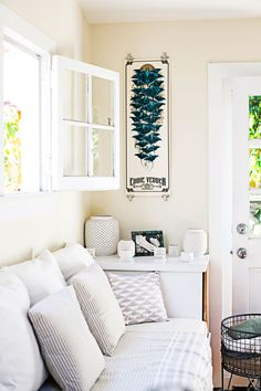 The couple filled the home with wall-to-wall white. It's crisp and clean — and it reflects light, making rooms look bigger. Smaller objects in the same palette (pillows and dishes, for example) blend seamlessly. To use every inch, Whitney stores her printer in a slim built-in cabinet that also serves as an armrest and side table. Bulldog clips provide an understated, frameless way to display art.  - GoodHousekeeping.com