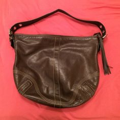 Brown leather coach purse Brown leather. Fringe zipper. Barely used. 3 pockets inside of the bag. Coach Bags Shoulder Bags