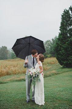 rainy day wedding portrait, photo by Jon Schaaf Photography http://ruffledblog.com/intimate-charlottesville-wedding #weddingportraits