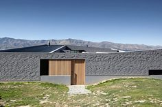 Lake Hawea Courtyard House, Otago by Glamuzina Paterson. Responding to historical precedents, the use of brick and the low singular form anchors the house firmly to its site.