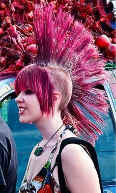 Now that's a mohawk! I like the bloody barbies behind her as well...