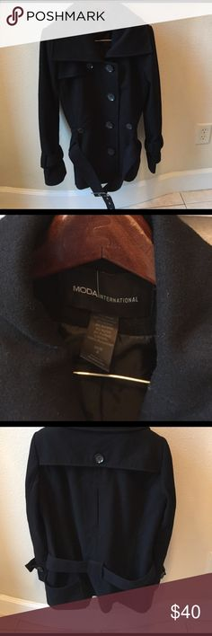 Stylish Black Wool Coat Moda International Wool Blend belted Coat. Shorter trench style. Very flattering. Live in Florida and maybe worn one or two times. Front button pockets and two front open pockets. Hardware on Belt is silver. Moda International Jackets & Coats