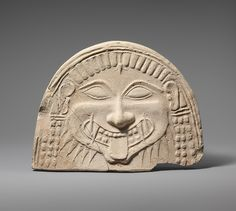 Archaic Greek Style Terracotta Antefix with the head of Medusa, Taranto, Italy, c. 6th century BC