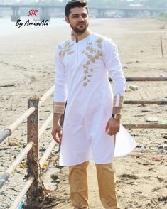 Mens Designer festive cotton pathani suit with collar neck, short button placket and full sleeves and curve hem. Comes with matching bottom. Kurta Pajama Men, Kurta Men, Indian Men Fashion, Mens Fashion Wear, African Clothing For Men, Mens Clothing Styles, Mens Traditional Wear, Pathani For Men, Boys Kurta Design