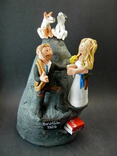 Mountain and Rock Climbers Wedding Cake Topper    Wedding Cake Topper for Mountain and Rock Climbers, custom created for you! Perfect for the marriage of a Mountaineering Groom and his Bride!    $235   #magicmud   1 800 231 9814   www.magicmud.com