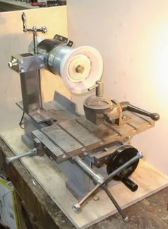 """Tool and Cutter Grinder by cfellows -- Homemade 3-axis tool and cutter grinder powered by a 5,000 rpm treadmill motor and fully adjustable for angle and height. Frame constructed from 4"""" channel and angle iron.  http://www.homemadetools.net/homemade-tool-and-cutter-grinder"""