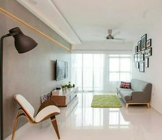 Simple, vintage furniture, tile floors, coloured wall, ceiling fan