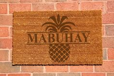 Nothing says Welcome or Mabuhay in Filipino better than a personalized Pineapple Welcome Mat. This classic 18 x 30 laser engraved doormat is the
