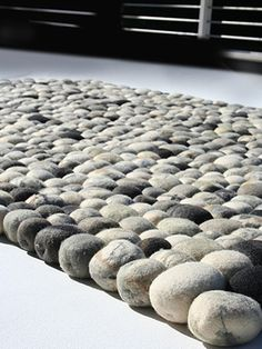 "Faux Pebble Rug Made Of Wool. I would actually love this as my ""headboard""!"