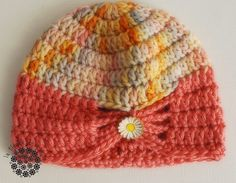 Crochet baby hat with a button